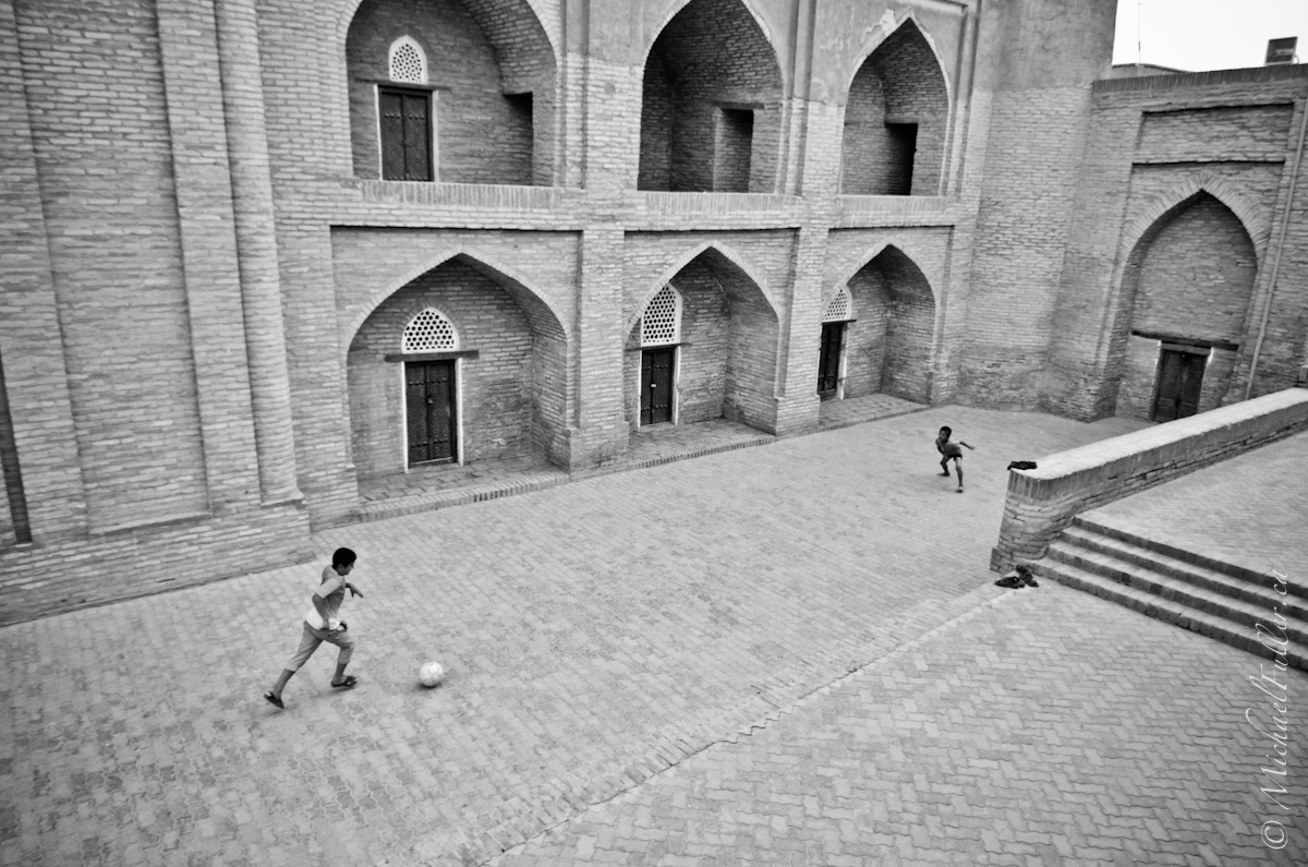 Kids in walled cities don't have many options for football pitches. These doors will do. (they were later chased away by a frightful witch of a woman)