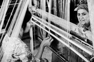Silk weavers working together in a textile factory.