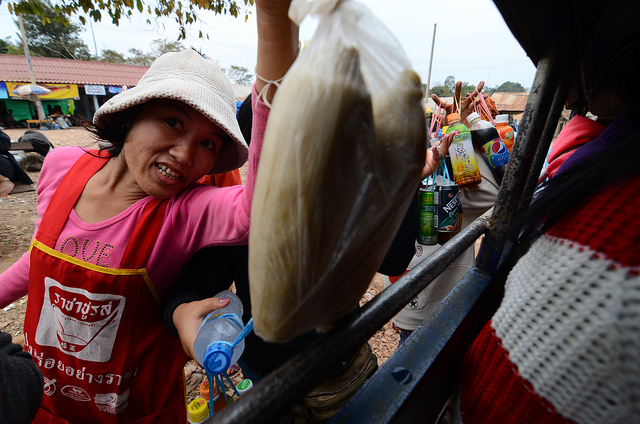 Woman selling corn in Laos