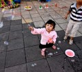 cute kids playing with bubble wands in Bukittinggi