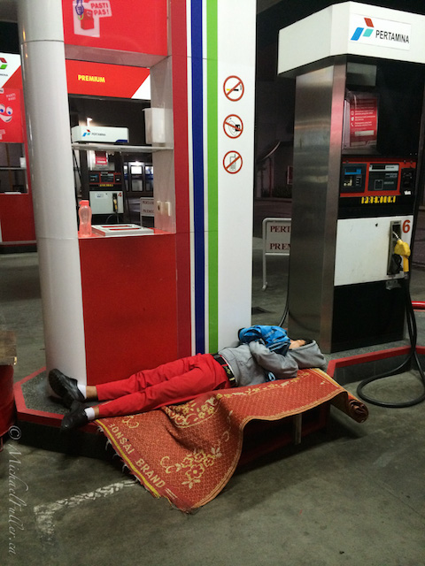 sleeping pertamina petrol station attendant