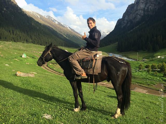 Myke on a horse in Kyrgyzstan