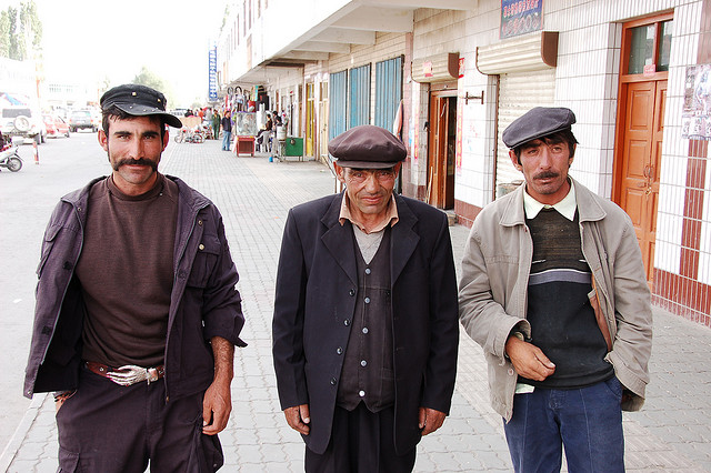 Locals on the street in Tashkurgan, Xinjiang