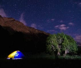 Camping at a river delta in the Pamir Mountains, inside a leaky $20 tent we named 'Oliver'.