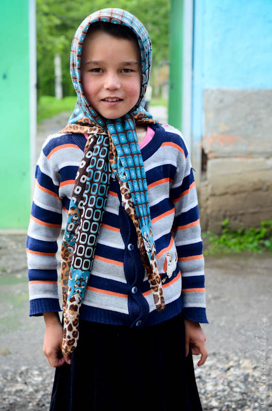 This girl, probably about 11 years old, watched over her younger neighbours. Most women around here were camera-shy and even hostile towards travellers - but she let me take a photo.