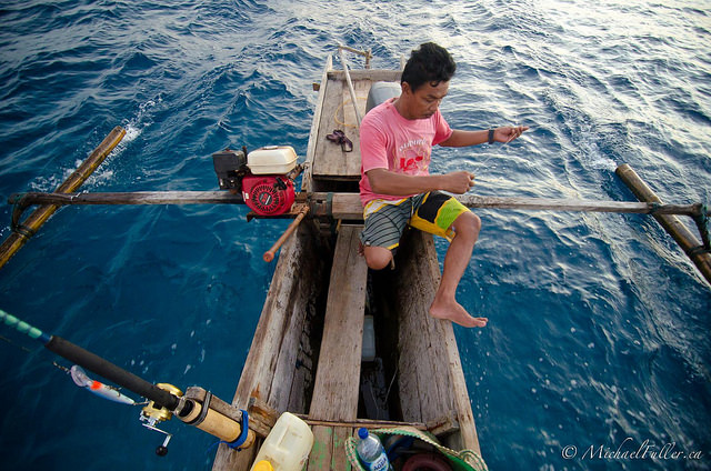 Fishing with Aka in his outrigger canoe.
