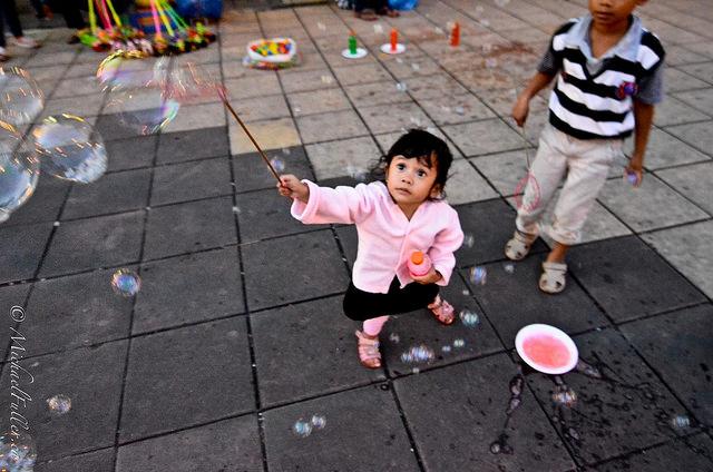 cute kids playing with bubble wands in Bukittinggi