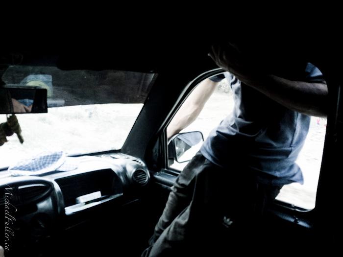 tajik man climbing onto car